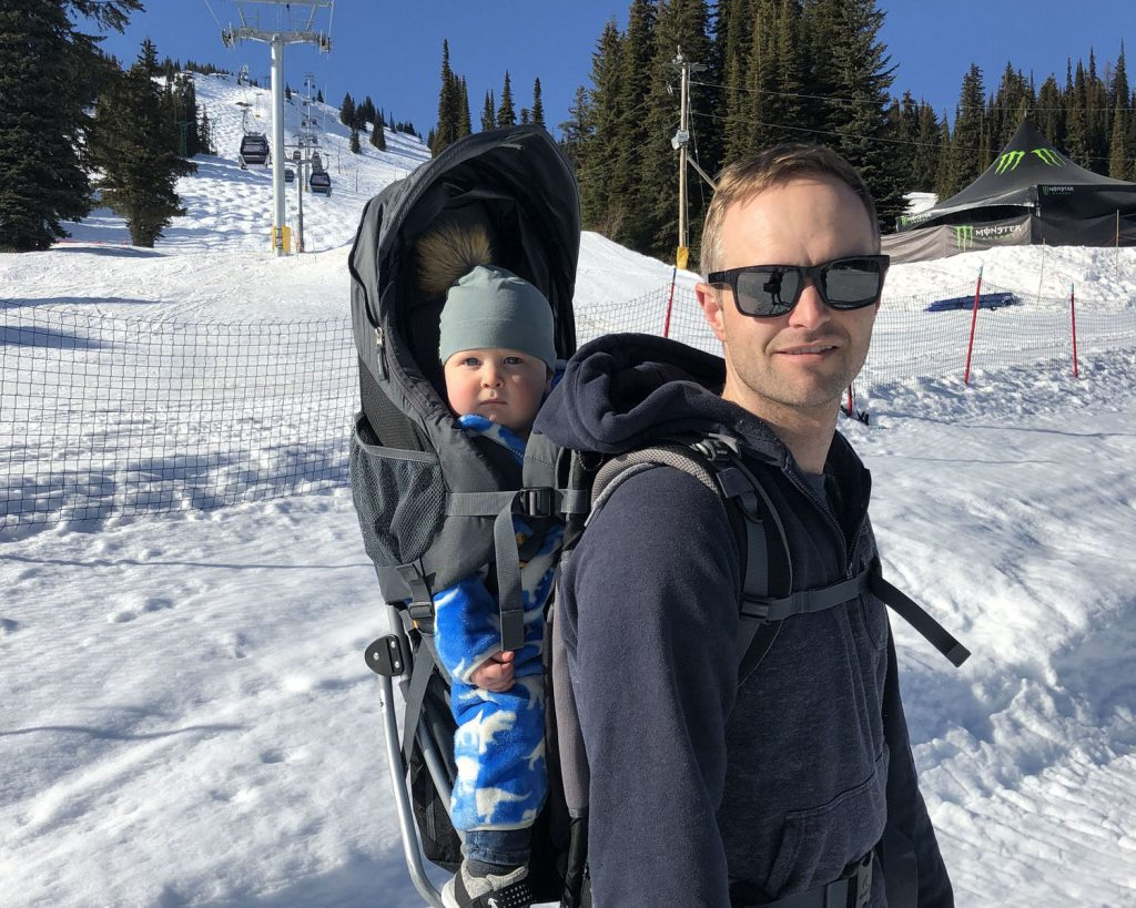 Will Devick of dlandco chartered professional accountants backpacking son Hudson during a ski trip in Revelstoke BC